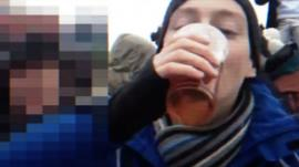 Man 'necking' a beverage