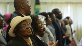 People singing during Redeemed Church service in Massachusetts