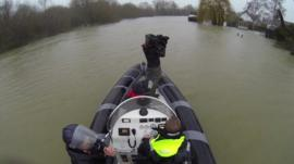 Boat with BBC crew on flood water