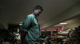 Yao Ming in a room full of elephant husks
