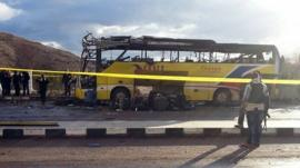 The wreckage of the tourist bus after a bomb explosion in the Egyptian south Sinai resort town of Taba