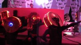 dancers in front of DJ
