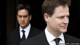 Deputy PM and Lib Dem leader, Nick Clegg, with Labour leader Ed Miliband in background