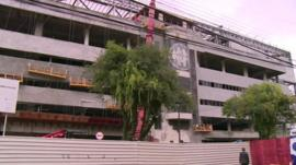 The unfinished exterior of the stadium