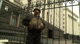 An activist from the Self-Defense group guards the Ukrainian Presidential building in Kiev