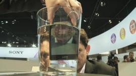 BBC Technology Correspondent Mark Gregory is shown the new Sony Xperia Z2 smartphone at the Mobile World Congress in Barcelona.