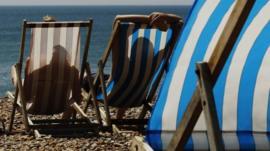 Couple sunbathing