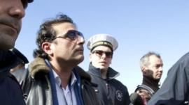 Captain Schettino in Giglio port after boarding the wreck of the Costa Concordia