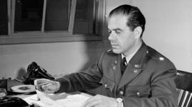 Frank Capra at his desk in the war department
