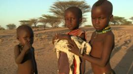 Children with lifeless goat