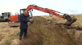 Roger Harrabin and a digger