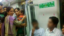 Men sitting on women only seats on Delhi metro