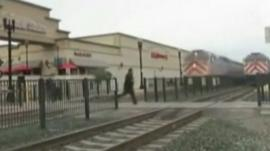 Man runs across train line