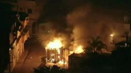Police containers on fire