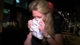 A woman sniffs a t-shirt at a pheromone dating event