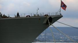 A sailor stands onboard a Russian Navy vessel anchored at a navy base in the Ukrainian Black Sea port of Sevastopol