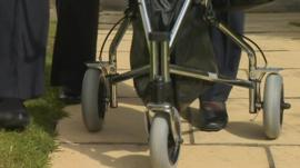 Woman using Zimmer frame