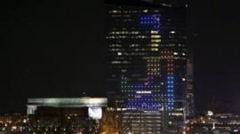 Tetris pieces illuminated on skyscraper