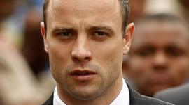 Oscar Pistorius arrives at court in Pretoria on 9 April 2014