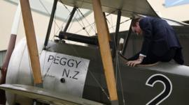 Prince William climbs into the cockpit