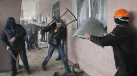 Pro-Russian men storm a police station in the eastern Ukrainian town of Horlivka