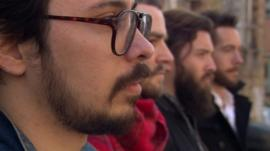 A row of men with beards