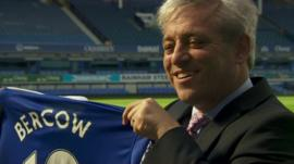 John Bercow holding football shirt with his name on it