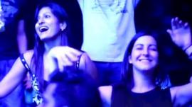 Two Indian women dancing at a night club