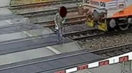 Man walks in front of train
