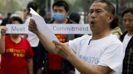 A relative of Chinese passengers onboard the Malaysia Airlines MH370 speaks to media