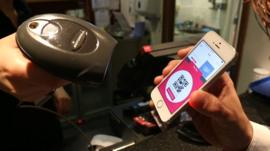 A mobile payment app being scanned