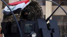 A member of Iraq's anti-terrorism force deployed outside a polling station in central Baghdad, 29 April 2014