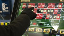 Person on a betting machine