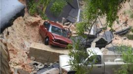 Two vehicles which fell 40ft when a scenic highway collapsed in Pensacola, Florida