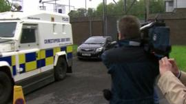 Gerry Adams leaving Antrim PSNI station