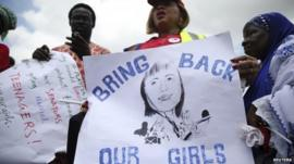 Protester holding sign reading 'Bring back our girls'