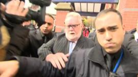 Paul Flowers leaving Leeds Magistrates' Court