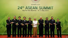 Leaders join hands for photo at ASEAN summit