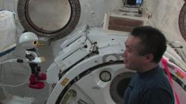 Kirobo and Koichi Wakata talking inside the space station