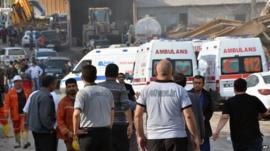 Ambulances at mine where workers in Turkey are trapped