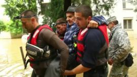 Recue workers carry elderly man