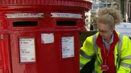 A woman at a post box