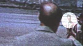 A close-up of the film footage with Dylan Thomas circled