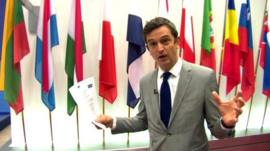 Matthew Price in front of EU nation flags