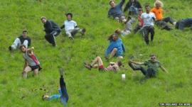 Competitors in the Cheese Rolling on Cooper's Hill race near Brockworth, Gloucestershire