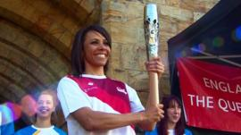 Dame Kelly Holmes with the Queen's Baton