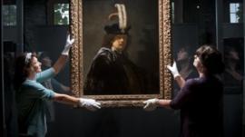 Rembrandt self-portrait being held
