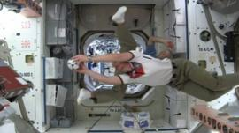 Astronauts playing with football in International Space Station