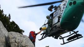 Helicopter brings supplies to mountain rescue team (12 June)