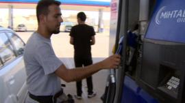 Man at petrol pump in Irbil, Iraq